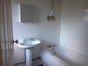 white bathroom suite in auction property