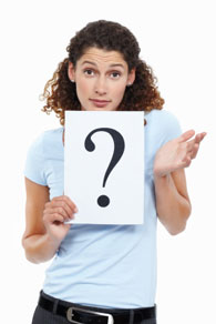 woman-holding-a-sign-with-a-question-mark-on-it.